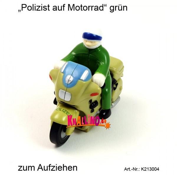 Polizist auf Motorrad grün zum Aufziehen
